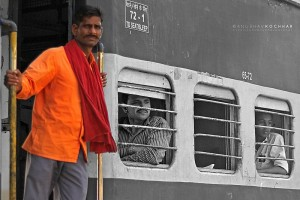 man leaning out of train