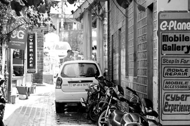 A parked car and motorbikes inside a lane in the Chamba valley town. Photo - Amit Sengupta
