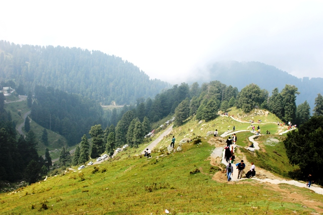 Tourists, young and old, alike, trekking at Khajjiar. This place is a popular trekking hotspot. Photo - Amit Sengupta