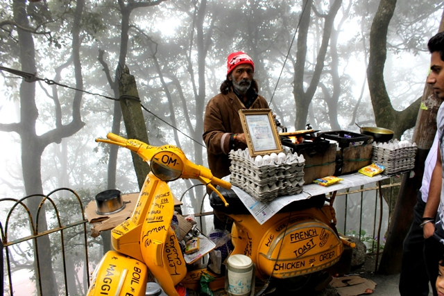 Sunil,  with his two-wheeler moving restaurant in Dalhousie gets a brisk business on a foggy day. Photo - Amit Sengupta
