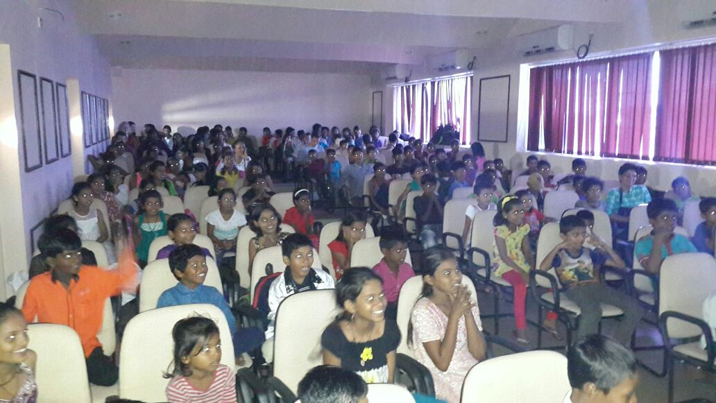 The kids of the Navjot Foundation enjoying a movie screening organised by volunteers