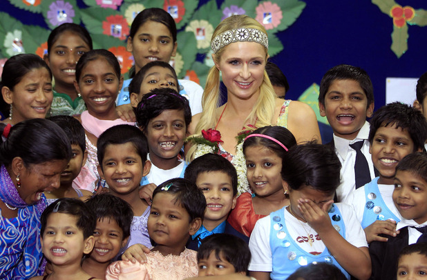 Paris Hilton spending time with Orphans Source