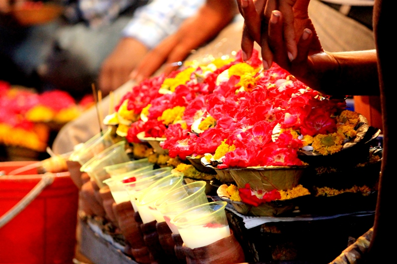 Milk with rose petals and flower pots are kept for worshippers outside Danghati temple. Photo: Amit M Sengupta