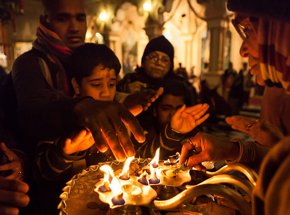 Devotees seeking blessings from the holy fire at Vrindavan. Photograph by Marji Lang