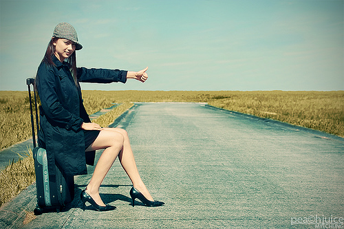 A woman looking to hitch-hike. Photo credits - Mye Chung, Flickr